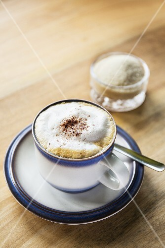 A cappuccino dusted with cocoa powder