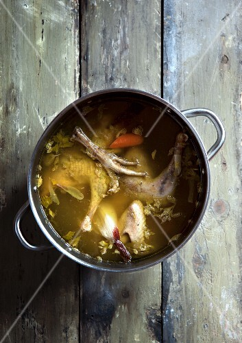 Chicken soup with carrots in a saucepan