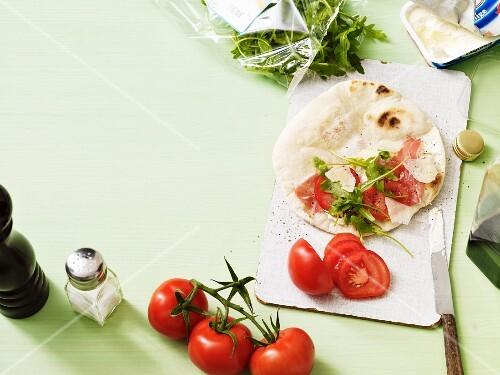 Piadina (unleavened Italian bread) with tomato and rocket