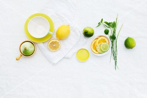 A teacup, lemons and limes