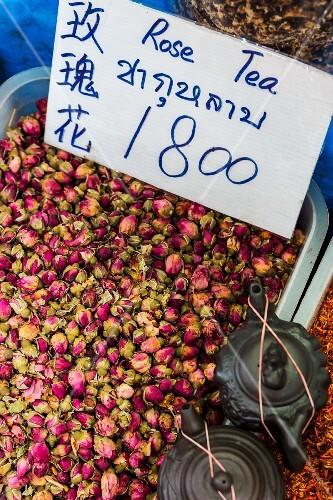 Rosebuds and teapots at a market in Bangkok