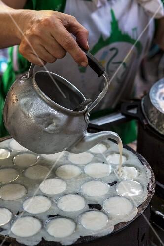 Kanom Krok (coconut dessert, Thailand) being made
