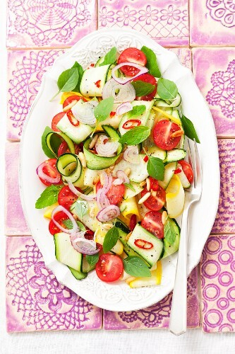 Courgette salad with cherry tomatoes, red onions, chilli peppers, basil and mint