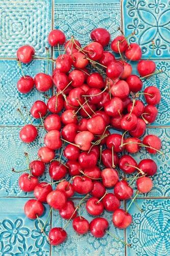 Fresh sweet cherries on a tiled floor