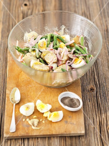 Potato salad with green beans, eggs, ham and a mustard dressing