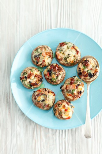 Mushrooms stuffed with dried tomatoes, mozzarella and herbs