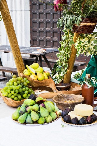 Fresh fruit and cheese on a buffet at a mediaeval festival