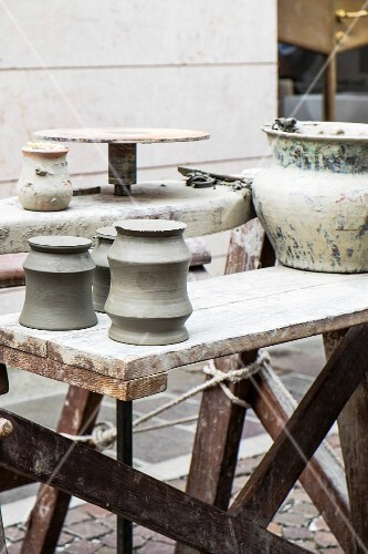 A potter's workbenches at a mediaeval market