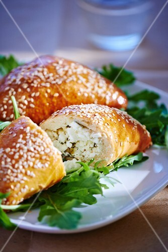 Sesame seeds turnovers filled with feta cheese