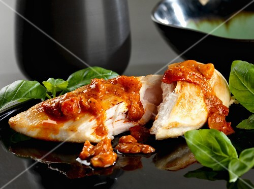 Chicken breast with pepper pesto and basil