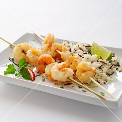 Prawn skewers with wild rice and limes