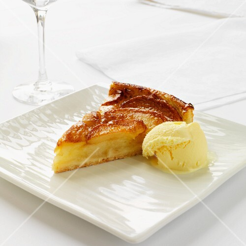 A piece of Tarte Tatin with vanilla ice cream