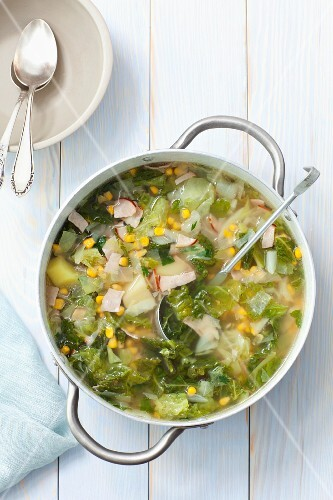 Savoy cabbage soup with potatoes, ham and sweetcorn