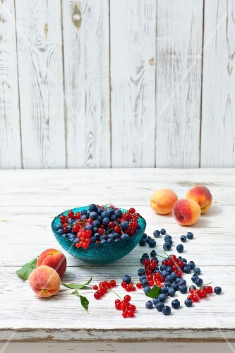 An arrangement of blueberries, redcurrants and peaches