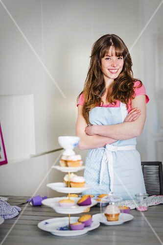 A young woman with homemade cupcakes