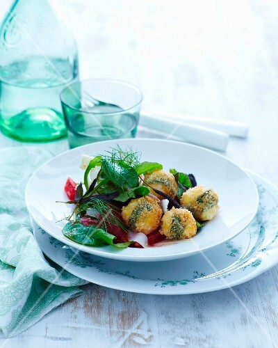 Fried mini mozzarella with sage and a herb salad