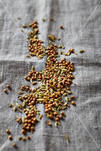 Cumin and coriander seeds on a linen cloth