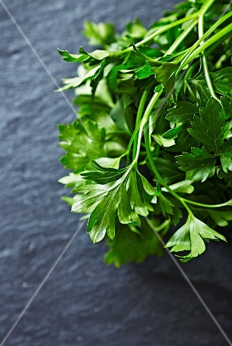 Fresh parsley on a slate surface