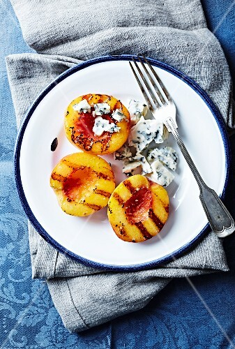 Grilled nectarine halves with blue cheese