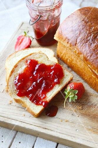 Strawberry jam on a slice of white bread