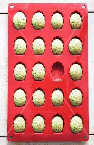 Pandan madeleines in a baking mould