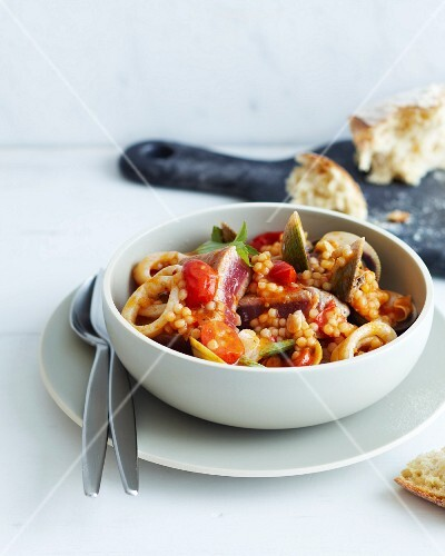 Tuna and seafood stew with couscous and tomatoes