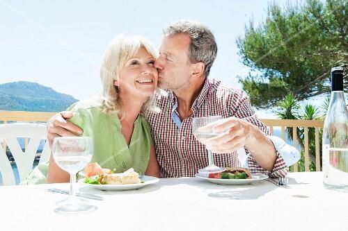 A couple eating on a terrace in Mallorca, Spain