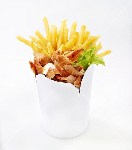 Donner kebab with chips in a takeaway container
