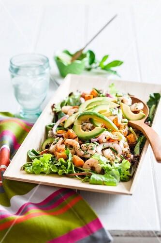 A mixed salad with pumpkin and prawns