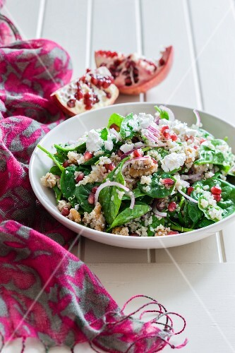 Quinoa salad with spinach and pomegranate seeds