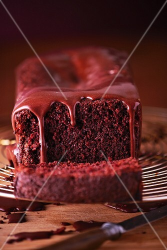 Chocolate glaze dripping down a chocolate cake