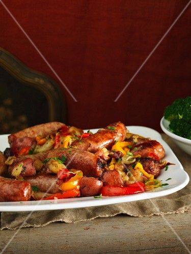 Sausages on a bed of vegetables