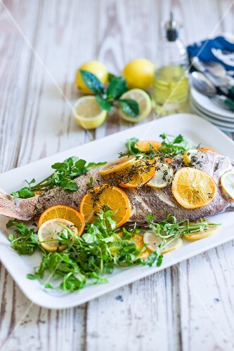 Red snapper with lemons, oranges and fresh herbs