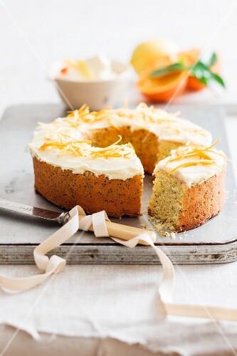 A poppyseed wreath cake with citrus fruit cream