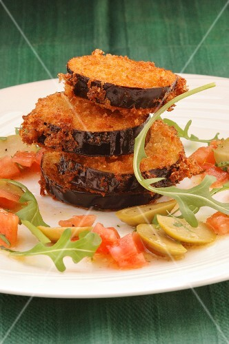 Breaded aubergines with olives and tomatoes