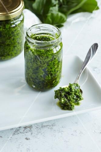 Wild garlic pesto in a jar and on a spoon