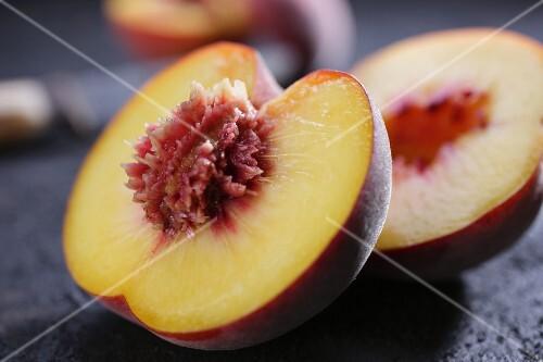 A peach, halved