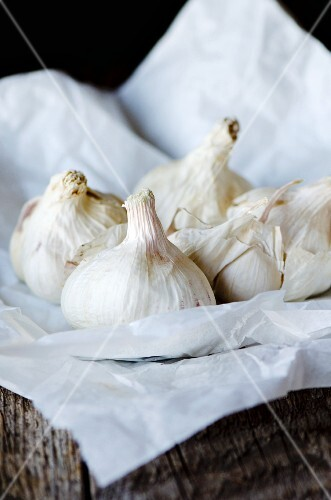 Garlic bulbs on greaseproof paper