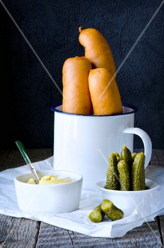 Smoked sausages with mustard and gherkins
