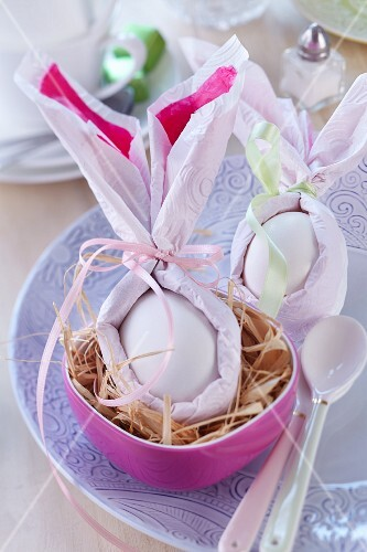 Boiled eggs wrapped in napkins formed into Easter Bunny ears for Easter brunch