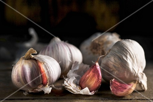 Pink garlic on a wooden surface