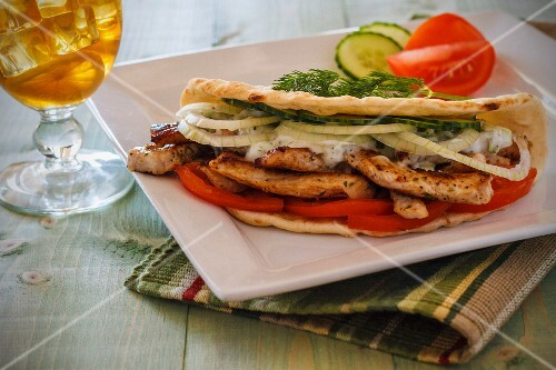 Chicken gyros with onions and tomatoes in pita bread