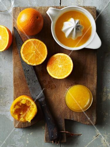 Freshly pressed orange juice and oranges