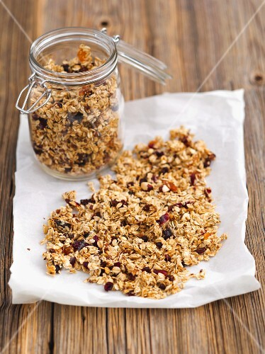 A jar of muesli with dried fruit and nuts