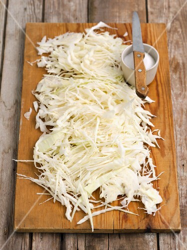 Shredded white cabbage on a chopping board