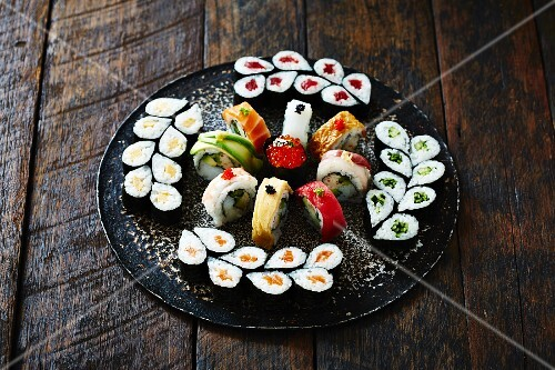 A sushi platter on a wooden surface