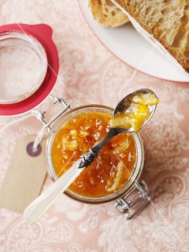 A jar of marmalade with a spoon