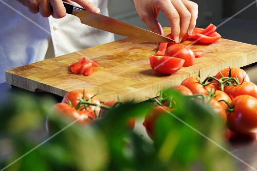 Tomatoes being chopped