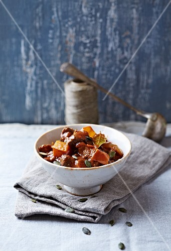 Beef goulash with pumpkin and mushrooms