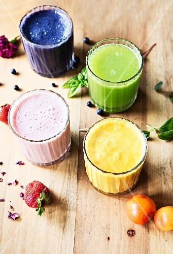 Fresh homemade smoothies made with various fruits and herbs